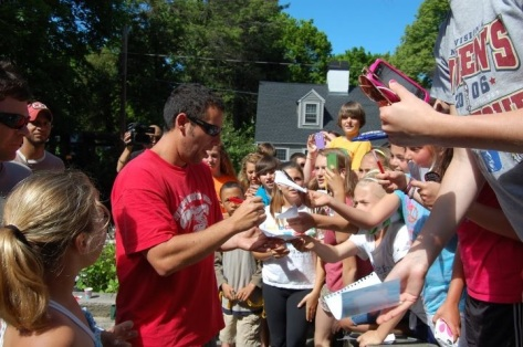 Lead Actor Adam Sandler signs autographs for a large crowd of his fans on the North Shore during filming of GrownUps2.