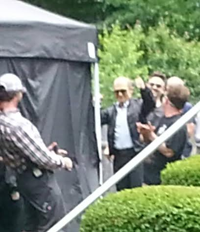 Johnny Depp waves to the crowd outside the tent on the Black Mass set for his Birthday wish